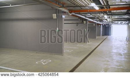Parking In A Residential Building. Covered Underground Parking For Cars. Underground Parking In A Re