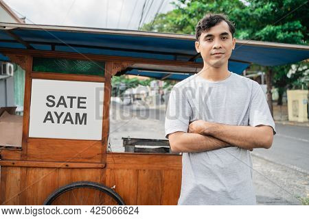 Man Street Food Seller Of Chicken Satay With Food Cart Selling Sate Ayam.