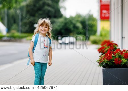 Cute Little Preschool Girl Going To Playschool. Healthy Toddler Child Walking To Nursery And Kinderg