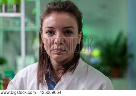 Portrait Of Chemist Woman In White Coat Working In Pharmaceutical Laboratory. Biologist Scientific A