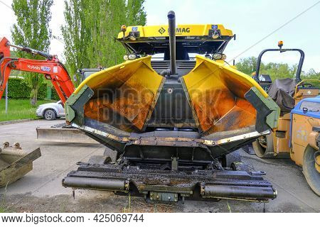 June 2021 Parma, Italy: Huge Yellow Heavy Road Machine Close-up Parked And Ready For Road Constructi