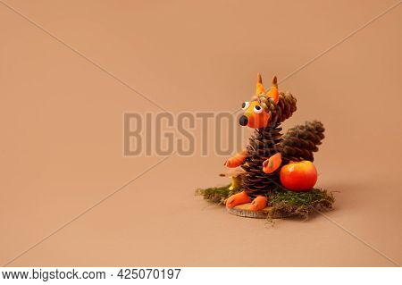 Autumn Crafts. Children's Fall Crafts And Creativity, Squirrel Made From Modeling Clay, Cones And Nu