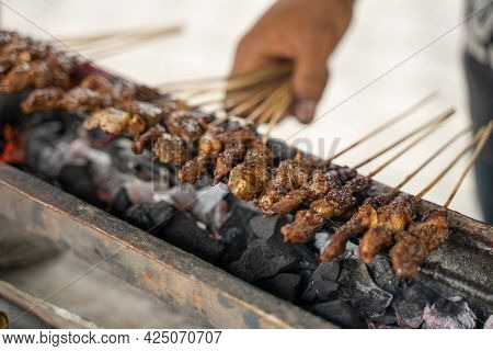 Sate Ayam Traditional Culinary Of Chiken Satay Skewer Being Grilled Using Charcoal