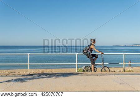 Palma De Mallorca, Spain; June 25 2021: People Exercising In The Morning On The Promenade Of Palma D