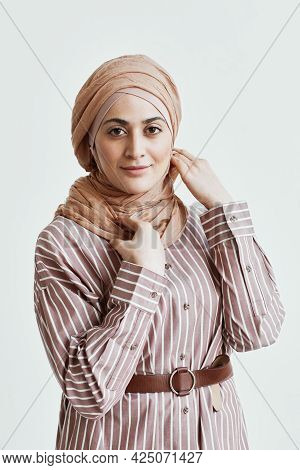 Vertical Waist Up Portrait Of Modern Middle-eastern Woman Looking At Camera And Wearing Headscarf Wh