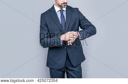 Confident Businessman Man In Businesslike Suit Watching Time On Wristwatch, Time