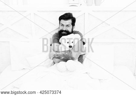 Man Hug Soft Toy Relaxing In Bed. Make Surprise Concept. Gift For Spouse. Cute Teddy Bear Toy. Softn