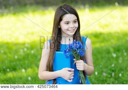 Happy Teachers Day. Happy Child Hold Flowers For Teachers Day. Little Girl Back To School. Teachers