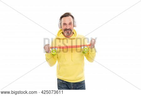 Man In Yellow Hoody With Skateboard. Adult Skateboarder. Male Casual Hipster Style.