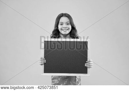 Information For You. Happy Girl Hold Blackboard Pink Background. Small Kid Smile With Blank Blackboa