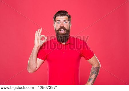 Best Haircut Here. Promoting Barber Services. Portrait Of Bearded Man Red Background. Brutal Guy Wit