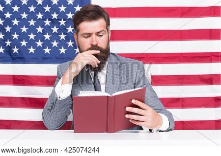 All Should Have Freedom To Pursue Education. Teacher Read Book On American Flag. Education In Usa. A
