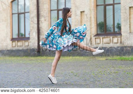 Fun Summer Activities For Kids. Happy Child Have Fun Outdoors. Energetic Girl In Stylish Dress. Play