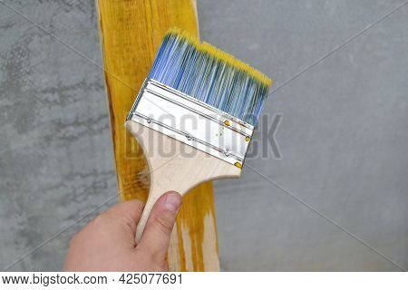 The Teenager's Hand Applies An Antifungal Solution For Wood Processing With A Brush.the Concept Of C