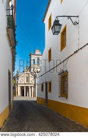View From The Narrow Street To The Facade Of The Igreja Da Graca Church Of Evora. Alentejo Portugal.
