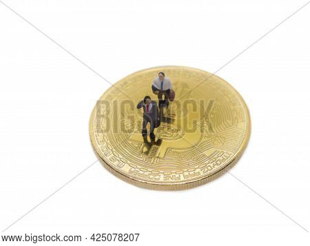 Miniature Businessman Walking On Golden Coins Of Bitcoin Cryptocurrency Digital Bit Coin Btc Currenc