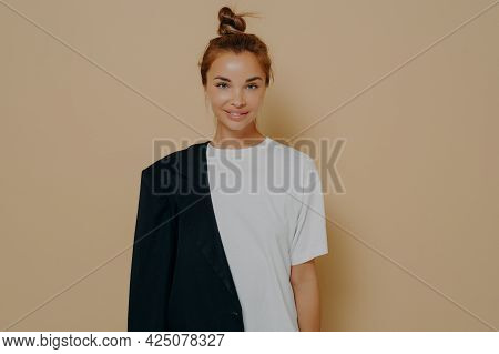 Stylish Young Female Student In White Oversized Tshirt And Black Blazer Tucked Over One Shoulder Wit