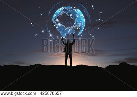 Backlit Businessman Holding Glowing Earth Hologram On Dark Night City Background. Global Innovation