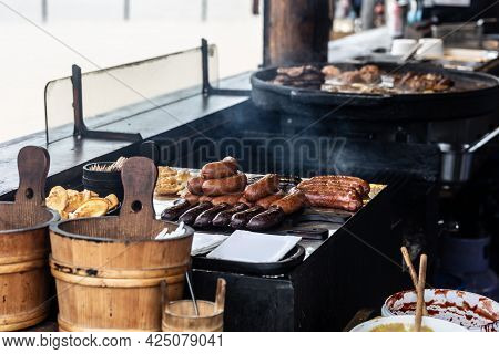 Various Fried And Grilled Meat And Cheese Served In A Traditional Restaurant Directly From The Hot P