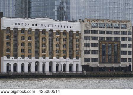London, United Kingdom - June 24, 2021: Historic Buildings Line The River Thames Near London Bridge