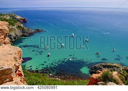 Bounty Beach At Cape Fiolent In The Crimea. Sea Lagoon With Boats And Yachts On A Sunny Summer Day.