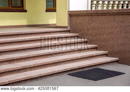 Exterior Of The Building Facade With Granite Steps Near The Porch With Windows And Balustrades Close
