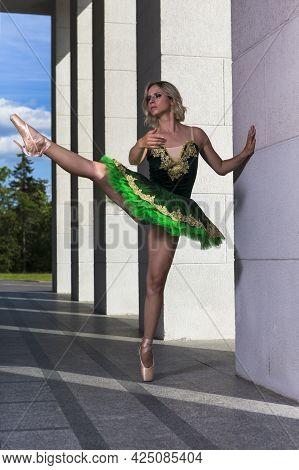 Dancing Ideas. Professional Caucasian Ballet Dancer In Green Tutu Dress Posing On Dancing Pose Outdo