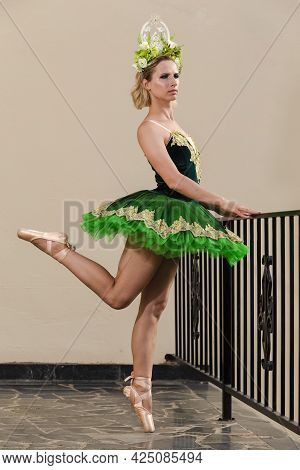 Choreography Concepts. Caucaisan Female Ballet Dancer In Green Tutu Dress And Artistic Flowery Crown