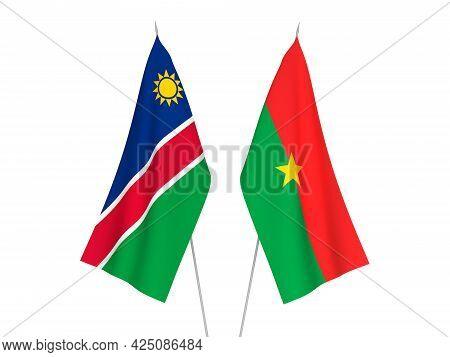 National Fabric Flags Of Burkina Faso And Republic Of Namibia Isolated On White Background. 3d Rende