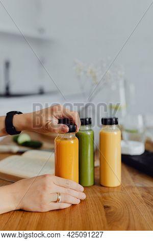 Homemade freshly squeezed juice in bottles