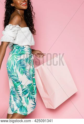 African American woman on a summer shopping spree