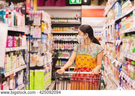Woman In Protective Mask Shopping In Supermarket During Coronavirus Quarantine