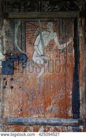 POIENILE IZEI, ROMANIA, JUNE 09 2021 -Old wooden church painting  in Poienile Izei village, Maramures county, northern Romania, Europe