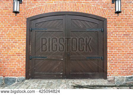 Black Wooden, Old Gate In A Brick Wall. Vintage Wooden Gate Effect.