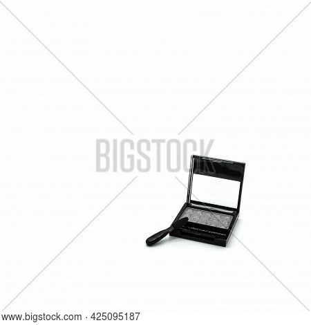 Makeup Accessories. Plastic Box With Gray Eyeshadow. Transparent Cover. There Is An Applicator Nearb
