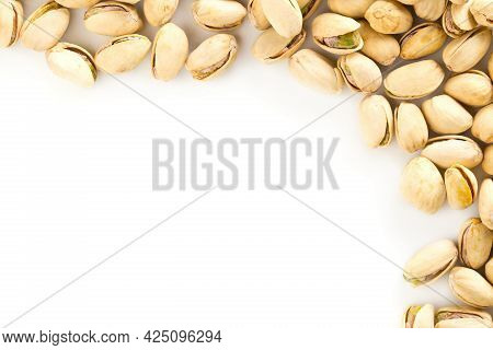 Border Of Salted, Roasted Green Pistachio Nuts Snack On White Background, Healthy Food Snack, Copy S