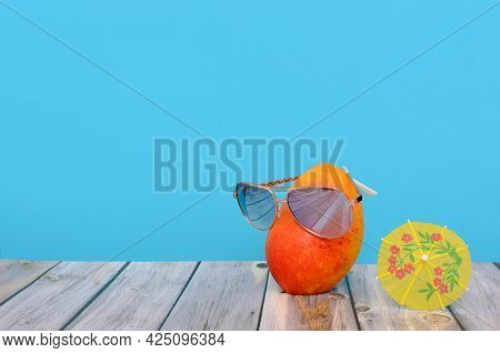 Mango With Glasses On Table With Shaker Umbrella. Summer Background.
