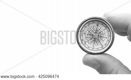 Round Compass In Hand Isolated On White Background For Abstract Image With Place For Text As Symbol