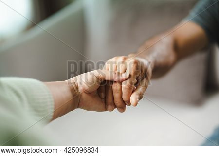 Female Friend Or Family Holding Hands During Cheer Up To Mental Depress Man, Psychologist Provides M