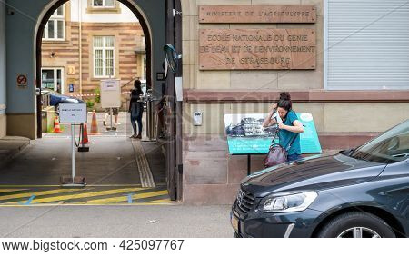 Strasbourg, France - Jun 27, 2021: Woman Searching For Documents In Bag At The Entrance Of French Po