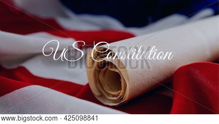 Composition of text us constitution, with scroll of antique documents on american flag. patriotism, independence and american constitution celebration concept digitally generated image.