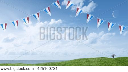 Composition of pennants with red, white and blue of american flag, over blue sky and green field. patriotism, independence and labor day celebration concept digitally generated image.