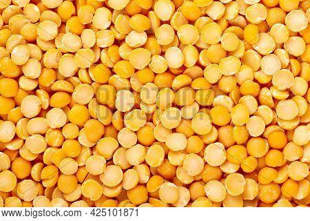Dry Yellow Split Peas Background. Halves Of Yellow Legume Peas.