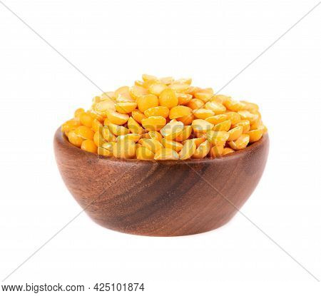 Dry Yellow Split Peas In Wooden Bowl, Isolated On White Background. Halves Of Yellow Legume Peas.