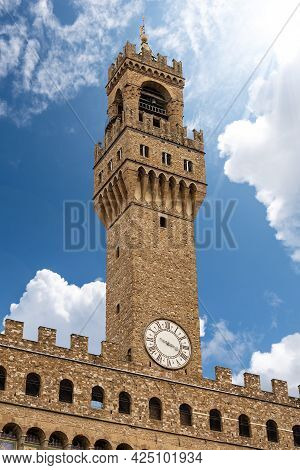 Florence, Close-up Of The Clock Tower Of Palazzo Vecchio (1299) Called Torre Di Arnolfo, Piazza Dell