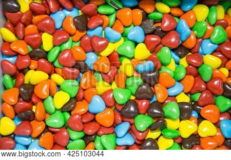 Chocolate Candies Of Bright Colors In The Shape Of Hearts. Fruits Nuts Vegetables Berries Useful Pro