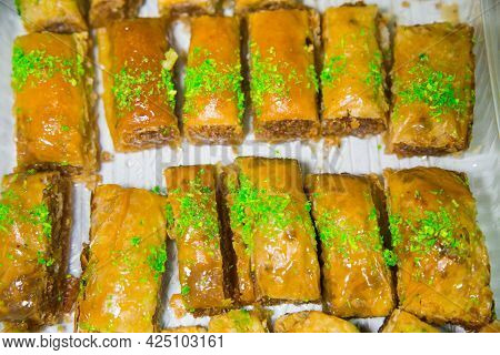Oriental Sweets Baklava Made Of Golden Puff Pastry With Rectangular Nuts Sprinkled With Green Pistac