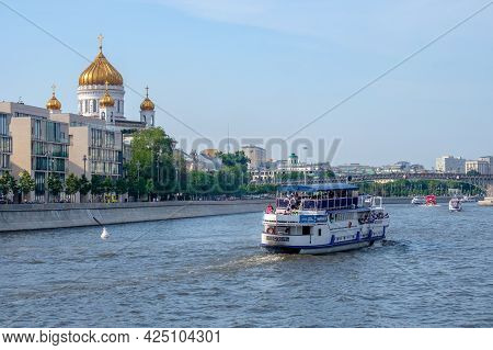 Moscow. Russia. June 26, 2021. View Of A Pleasure Boat Sailing Along The Moscow River, Against The B