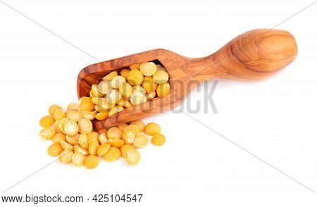 Dry Yellow Split Peas In Olive Scoop, Isolated On White Background. Halves Of Yellow Legume Peas.