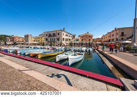 Bardolino, Italy - May 26, 2021: Port Of The Small Village Of Bardolino With Fishing Boats Moored, T